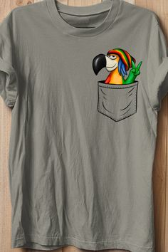 This casual apparel features a cool reggae parrot, your favorite colorful bird peeking out of a fake breast pocket. Peace out, a pocket-parrot! NOTE: The pocket is printed, NOT real! Perfect gift idea for every passionate reggae rasta lover, for fans of ragga, reggaeton, raggamuffin. This parrot stands out for values like peace, love, diversity, equality, tolerance and freedom - and total chillness, of course.