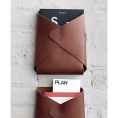 great wall-mounted storage. love these leather envelopes for collecting papers, books, magazines. bedside storage inspiration for my tiny house.