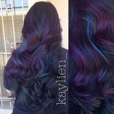 Peacock hair. Teal and purple peekaboos with deep deep violet brown base.