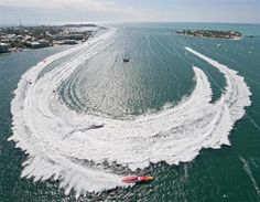 Superboat Extreme offshore race boats make the turn at the Key West World Championship in Key West, Florida in this November 9, 2012 handout photo supplied by the Florida Keys News Bureau.  REUTERS-Andy Newman-Florida Keys News Bureau-Handout