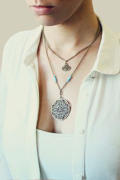 Handmade, boho / hippie style layered necklace by ANANKE Jewelry. Inspired by the nature. It has 2 pendants, Mandala and Lotus flower. Antique brass chains, glass beads. Designed as a unisex necklace, so it can be a great gift for him or for her. All the layers are connected to one clasp. If you wish to order this necklace as a set of 2, so you can wear each separately, just note it at checkout. _________________________________________________________ ♦ MEASURES: Pendants: Mandala 1.5 ...