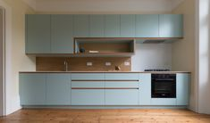 Bespoke Kitchen in custom laminated birch ply with corian work-surfaces, and solid oak detailing.