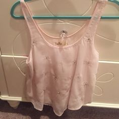Cute see through light pink hollister tank top! Good for hot summer days or even as a cover up shirt for a beach trip Hollister Tops Tank Tops