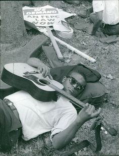 Vintage photo of A man wearing shades lying on grass and strumming the guitar h in Collectibles, Photographic Images, Contemporary (1940-Now), Other Contemporary Photographs   eBay