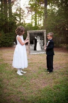 Wedding in Houston, TX  Cool idea  ((kinda looks like what it inside the frame is black??... Cool.))