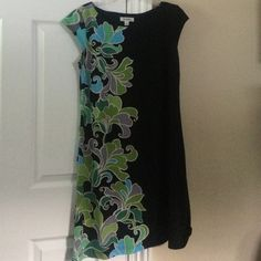 Gorgeous summer dress Fabulous and unique...black shift dress with green, gray and blue floral detail in front and back is perfect for any occasion! In excellent condition-no signs of wear. Falls right above the knee. Size 10. From a pet and smoke free home. ❌NO TRADES❌ Dress Barn Dresses