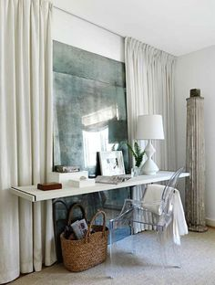 Antiqued mirror & draperies that give the illusion of a window, floating desk