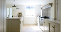 The Barnsbury Islington Kitchen | deVOL Kitchens. tile backsplash with shelf on top, nice