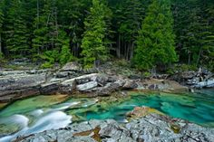 Beautiful turquoise blue water flowing in McDonald Creek in Glacier National Park, Montana