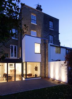 Contemporary extension to victorian townhouse in kingston.  duncan foster architects