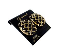 This is a pair of chunky vintage square shaped clip on earrings with raised gold tone zig zags and black enamel. They are signed Giovanni and come on the original card. 1980s. New comfort pads included. Made In The USA.  Measurements: 1 inch long x 5/8 inch wide.  Condition: These appear to have never been worn. They are still on their original card. A pair of fresh comfort pads will be included. A small amount of patina may be present from storage. No finish or enamel loss.  Here is a w...
