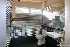 LineSync Architecture tiny accessible house for wheelchair users. No kitchen but a large bedroom and bathroom.