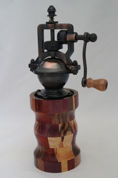 "This peppermill has an antique-style peppermill mechanism that adjusts easily from coarse to extra fine. The metal is an Antique Brass finish. It does not accommodate salt since it is metal. The body of the mill contains 120 pieces of exotic woods. It is approx. 2.5""dia. x 8""H. Cards for the Care of Wood and the names of all the woods and origin are sent with the purchase. # 626  0812"