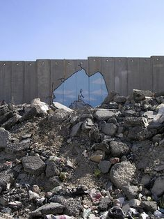 Well-known UK graffiti artist Banksy hacks the Wall | The Electronic Intifada