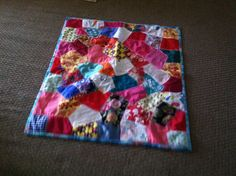 Use scrap clothes,blankets,or even good fabric to creat a blanket of memories.