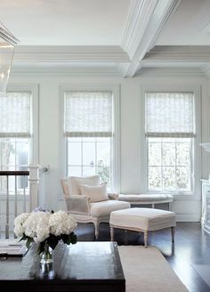 Whitewashed (manually, I think) wooden matchstick blinds! Seen on Lauren Bern's blog - click through for full post.