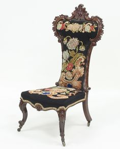 A Victorian prie-dieu with carved frame and needlework back and seat