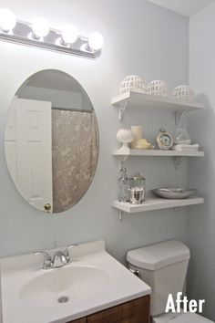 After: A thrifted medicine cabinet brings a bit of elegance to a small bathroom #diy   http://www.littlehousebigcity.com/home/2014/8/28/from-the-window-to-the-wall