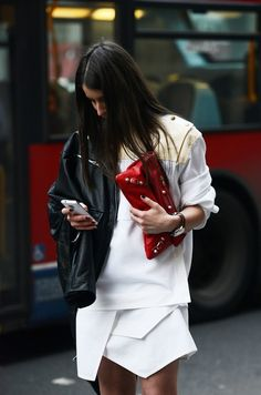 Lets make the outfit a little racy with a leather jacket a red purse