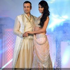 Rohit Roy and Sonal Chauhan pose together in designer Neeta Lulla's creations during 'Shehnaai' show, held in Mumbai, on March 29, 2013.
