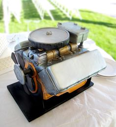 grooms cake idea (i better make sure this is an engine to a car he actually likes...and the decorator better pay attention to detail - he'll notice!! lol)