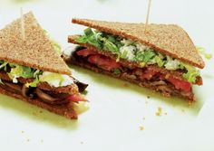 These trim, elegant sandwiches make a perfect lunch or hors d'oeuvre. They aren't hard to prepare, but there are a couple of things to keep in mind as you assemble them: shred the lettuce and slice the tomatoes and mushrooms very thin; doing so will help the sandwiches hold together and make them easy to nibble.