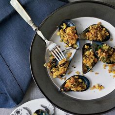 Mussels on the Half Shell with Curried Crumbs | This is inspired by the classic Bordelais mussels in curry cream. These plump mussels are topped with garlic-curry-bread-crumb butter then broiled.