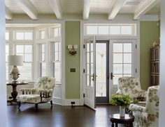 Beautiful: love the amount of natural light and the green, white, dark wood accent combo. Also like the ceiling.