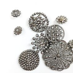 ButtonArtMuseum.com -#FASTENatingmoments Cut steel buttons were first created to imitate diamonds in 18th Century France! These sparking buttons were created with pinheads of faceted steel hand-riveted into a brass framework. #ButtonJunkies #antiquebuttons #grandmothersbuttons #cutsteel #WearableHistory