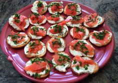 Bite Size Lox and Toasted Bagels: Smoked salmon (cut to size), toasted bagel chips, chopped chives. Cream cheese recipe: in mini-food processor combine, to taste, plain cream cheese, capers, lemon juice, chopped chives. Choose unbroken bagel chips, spread cream cheese blend, add smoked salmon (lox). Display on platter. Sprinkle with chopped chives.