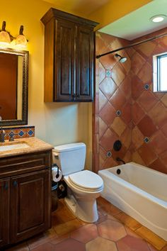 Love the branded towels and the mexican style tile in the for Terracotta bathroom ideas