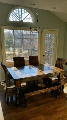 Solid wood Balluster Table stained entirely in Dark Walnut with matching Dianne Bench and Banana Leaf Chairs.