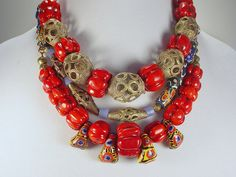 Statement Necklace of three separate strands with red coral and Kiffa beads by DeerwomanDesigns now on Etsy.  Special price