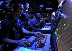 Air Traffic Controller 2nd Class Jedidiah Spencer mans the departure control station during flight operations aboard USS Makin Island (LHD 8).