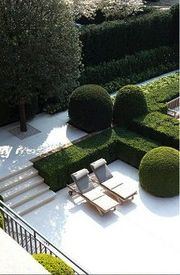 groomed topiaries and hedges provide green sculptures in the garden