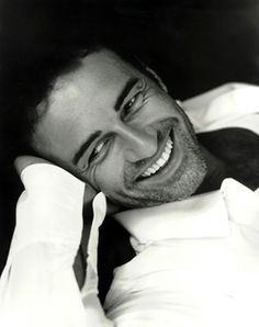 Julian McMahon..okay, so HE has pearly whites and a mighty fine physique...but he's not a Tom, Dick or Harry...he's a Julian mfkn Mcmahon! =D