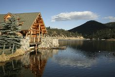 Evergreen Lake House, nestled in a scenic park at the edge of Evergreen Lake, is…