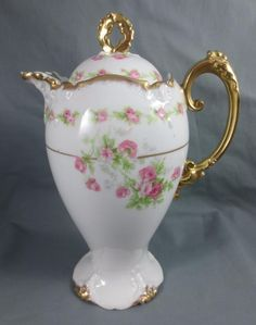 LIMOGES France MARSHALL FIELD & CO. Porcelain Chocolate Pot with PINK ROSES This beautiful porcelain chocolate pot was manufactured in Limoges France, exclusively for Marshall Field & Co. of Chicago.