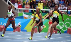 eronica Campbell-Brown (JAM) hands off to Shelly-Ann Fraser-Pryce (JAM) during the women's 4x100m relay heats.