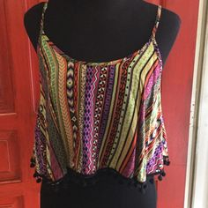 Pom Pom crop top Has a lining that with elastic that cups under the bust. EUC Wet Seal Tops Crop Tops