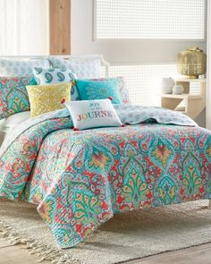 Floral Paisley Luxury Quilt Collection - Update your bedding ensemble with the Tribeca luxury quilt featuring a colorful paisley pattern with vermicelli stitching.  Reverses to a coordinating print.