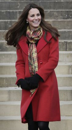 Kate Middleton Style: While outside, Kate tempered her red Armani coat with the necessary cold-weather accoutrements: a plaid scarf and black gloves.