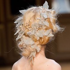 At the Georges Hobeika show, gorgeous silver and champagne hair garland was woven into the hair, further proving that wreaths and garlands are having a moment.