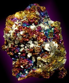 Chalcopyrite is the most commonly found copper mineral and is the most important ore of copper.    It gets its name because it has the same gold colour as pyrite. The surface of this mineral is often tarnished with a dark green, blue, purplish iridescent coat, earning it the name of peacock copper.  http://www.sinaya.net