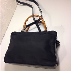 "Gucci Vintage Bamboo Handle Shoulder Handbag Gucci Vintage Bamboo Handle Shoulder Handbag .. Serial # 000.2040.0538 ... Color: Black ... Material: Canvas / Leather ... Length: 11"" ... Height: 8"" ... Width: 3"" ... Handle: 4.5"" ... Shoulder strap drop: 18"" ... Guaranteed Authentic ... Features: Detachable shoulder strap ... Zippered exterior pocket ... Top zippered closure ... Zippered interior wall pocket ... Condition: Excellent preowned condition Gucci Bags Shoulder Bags"