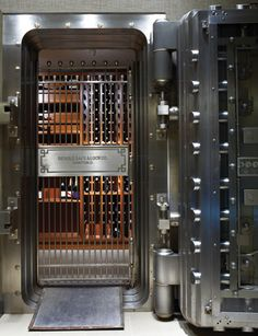Wine Vault Cellar - Minneapolis, Minnesota....I have seen this cellar first hand....this picture is great, but it is so gorgeous in person.. Great use of a beautifully, designed space with tremendous architecture.