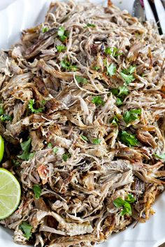 Slow Cooker Carnitas Recipe - Great for carnitas tacos, burritos, nachos and more. The little trick at the end gets the carnitas nice and crispy with no frying!