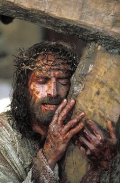 "Jim Caviezel playing Jesus carrying the corss in ""The Passion of the Christ"""