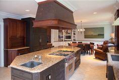 HISTORIC HEIRESS MANSION Kitchen - custom built ins, vented gas stove top in island Tuxedo Park, NY Tuxedo Park Estates 845.351.5000