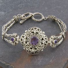 You'll be raking in the compliments with this handcrafted silver bracelet. Featuring genuine amethyst stones, this beautiful piece was designed and made by Indonesian artisans. Fastened with a toggle closure, this 'Cawi' bracelet is sure to turn heads.